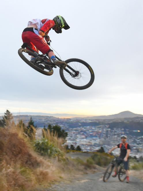 Otago downhill champion Calum Booth (Dunedin) takes a jump on the Signal Hill downhill track as...