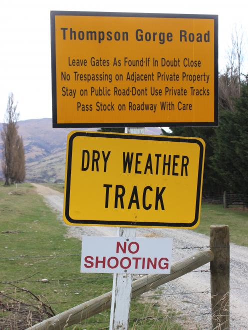 A sign states no shooting is allowed in an area in the Dunstan Mountains, near Omakau, where two...