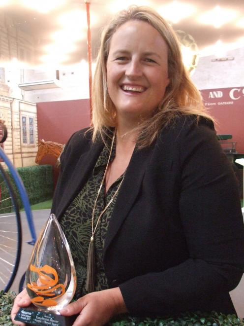 Design Federation director Annabel Berry stands by the carousel at Whitestone City with the...