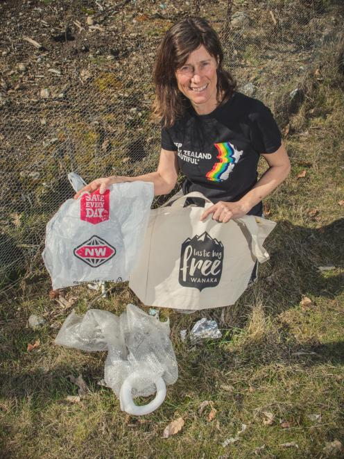 Gina Dempster, with a reusable Plastic Bag Free Wanaka shopping bag, finds plastic bags lying...