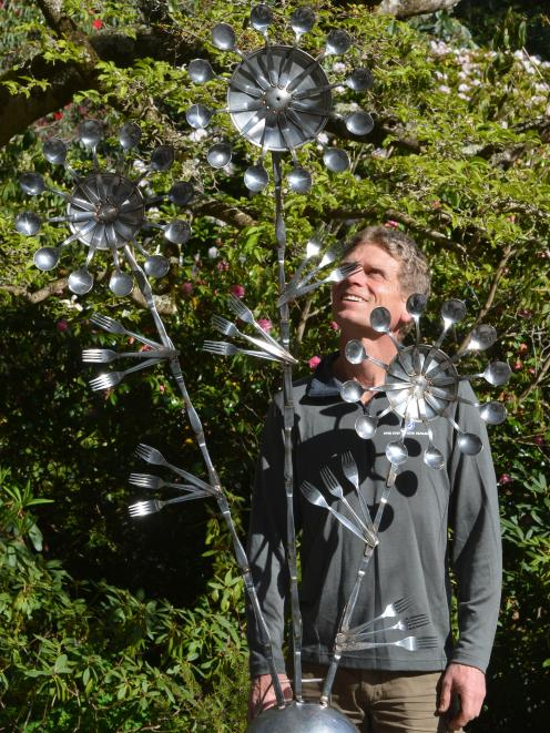 Glenfalloch gardener Alan Funnell with the sculpture he built from old cutlery for the Glenfalloch garden. Photo: Stephen Jaquiery