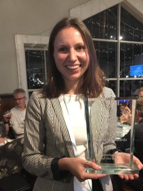 Dr Olya Shatova, of Oritain, holds the award for NZ's biotechnology company of the year at the NZBIO awards ceremony. Photo: Supplied
