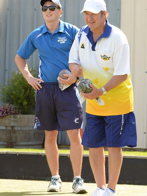 Australian-based Mark Watt (left) watches  as Gary Lawson, of Christchurch, lines up his delivery...