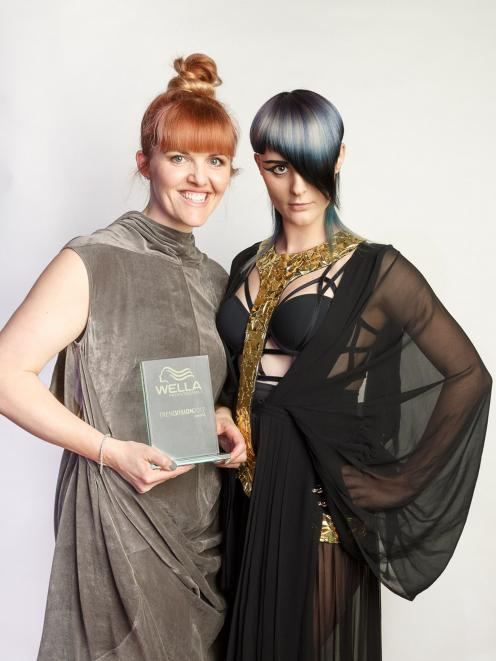 Kylie Hayes (left), of Moha Hairdressing in St Kilda, with her model wearing the hairstyle which won Mrs Hayes the creative vision platinum award at International TrendVision 2017. Photo: Supplied