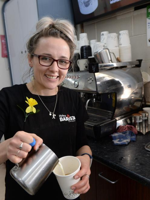 Gemma Thomson has been crowned the top barista for the Night 'n Day chain of stores. In the finals, she and two other finalists had to make five randomly chosen cups of coffee in seven minutes. Photo: Linda Robertson