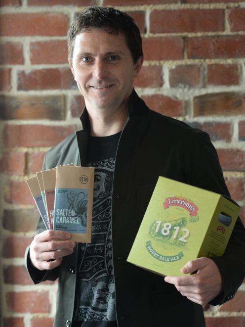 BrandAid owner Luke Johnston with two of the products he has won packaging awards for. PHOTO:...