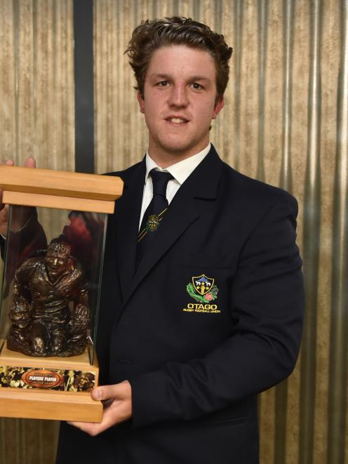 Otago second five eighth Tei Walden holds the David Latta Trophy after being presented with it at the Otago rugby awards ceremony at the Mornington Tavern last night. Photo: Gregor Richardson