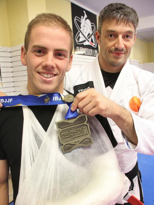 Dunedin jujitsu exponent Conor Middleton and Submission Lab president Benoit Auvray with the...