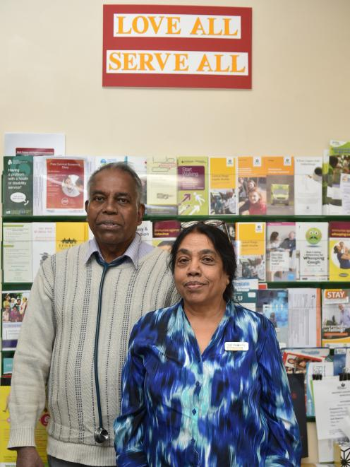 "Dr Rama T Ragupathy and his wife Villi in Dunedin yesterday underneath their motto: ""Love All..."