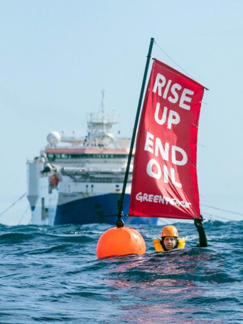 Three Greenpeace activists including Greenpeace NZ executive director Russel Norman swam in front of the 125m Amazon Warrior nicknamed 'The Beast'. Photo: Greenpeace