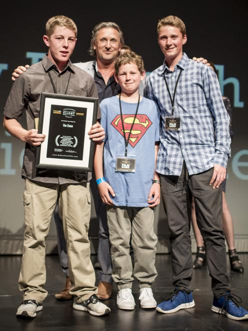 Benaiah (15) and Thomas Dunn (12), Jack McAtamney (15), all of Mosgiel, and judge Tim Balme at the Youth Silent Film Festival NZ regional finals awards night on Tuesday. Photo: Brydie Photography.