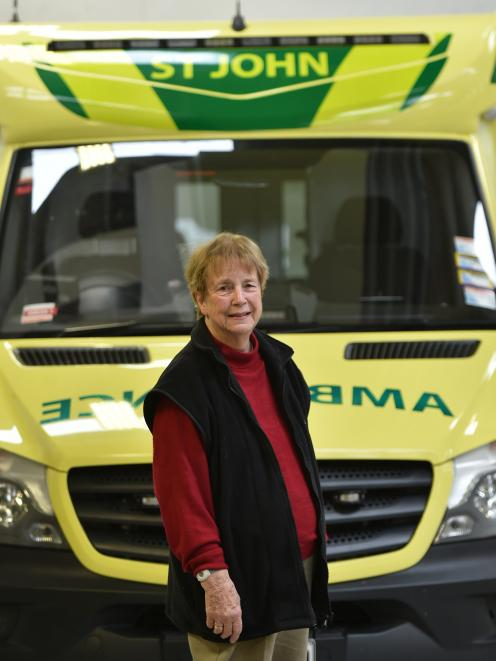 Long-time St John Dunedin committee member Joyce Whyman in the organisation's York Pl ambulance...