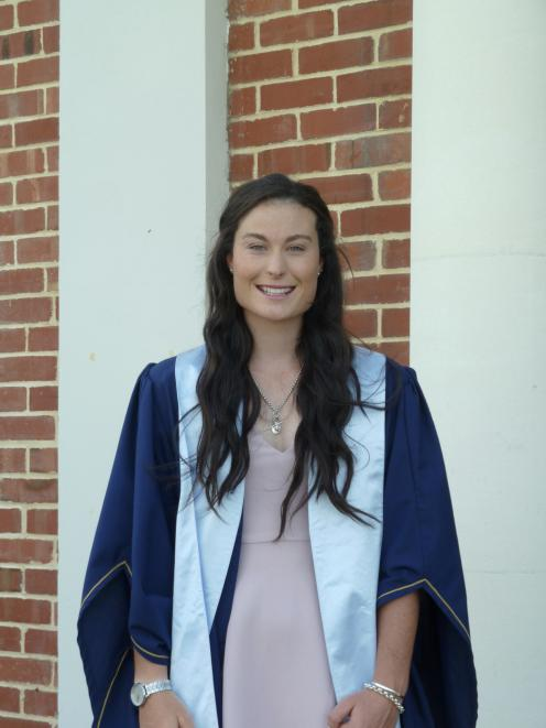 Performance analyst Anna Higgins in her Otago Polytechnic graduation gown. Photo: Supplied