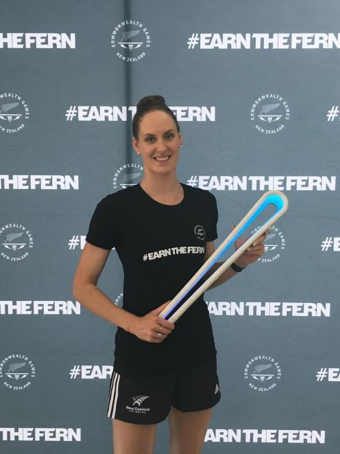 Carina Doyle with the Commonwealth Games baton at the announcement of the New Zealand swimming...