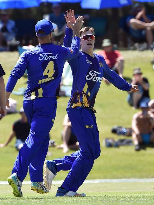 Otago Neil Broom,left celebrates rookie bowler Ben Lockrose wicket during the Otago Volts against...