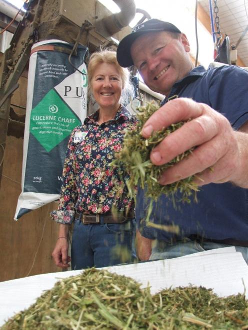 Henrietta and Graeme Purvis, of Purvis Feeds, at Waianakarua, with their lucerne chaff. Photos:...
