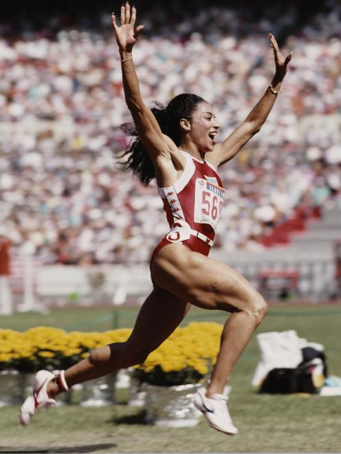 American Florence Griffith-Joyner celebrates winning gold in the women's 100m final during the...