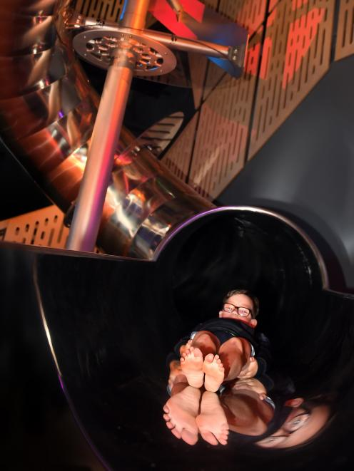 Abbotsford Primary School pupil Nieko Scoles (8), of Outram, enjoys a sneak preview of the museum science centre's ''totally savage'' new double helix slide. Photo: Stephen Jaquiery.