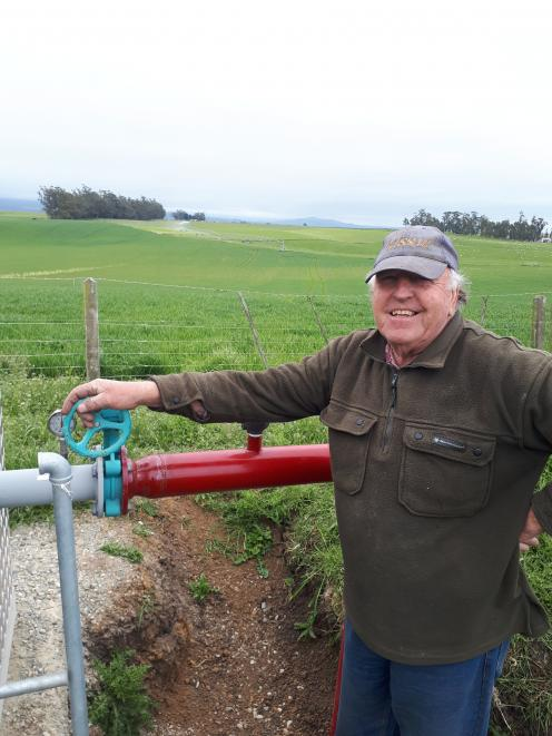 Bruce Dalgety turns on the water on the family's Kakanui farm. Photo: Supplied