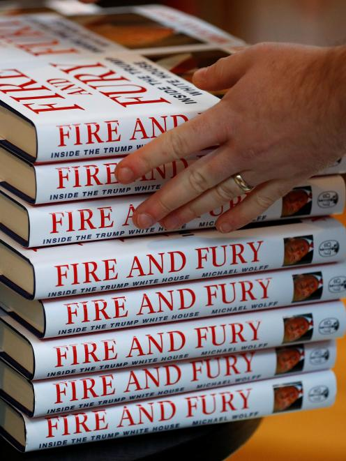 A shop worker arranges copies of Michael Wolff's book 'Fire And Fury'. Photo: Reuters
