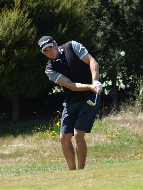 Blake Mason, of Wanaka, plays a chip shot on the 14th fairway in the first stage of qualifying...