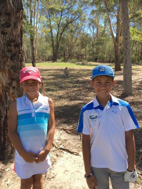 Golfing prodigies Anahera (8) and Kairangi (9) pause for a photograph with a kangaroo while at Riverside Oaks Golf Resort last month. Photo: Supplied