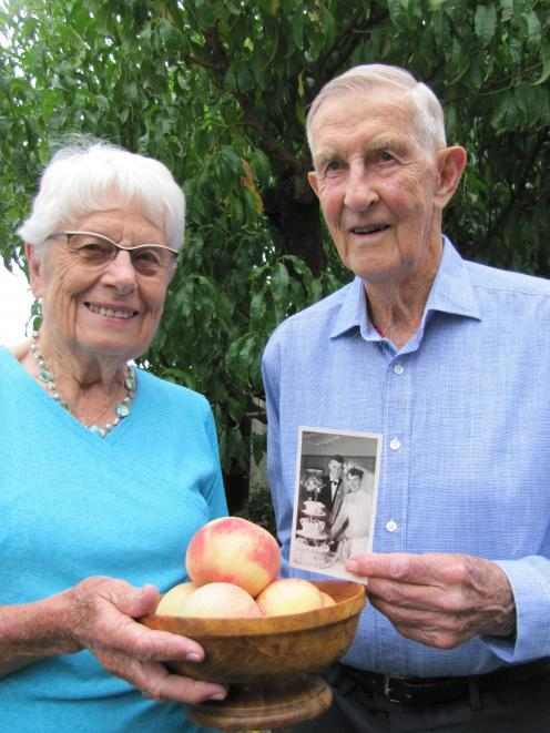 Alexandra couple Shirley and Jack Alabaster celebrate their 65th wedding anniversary flanked by a...