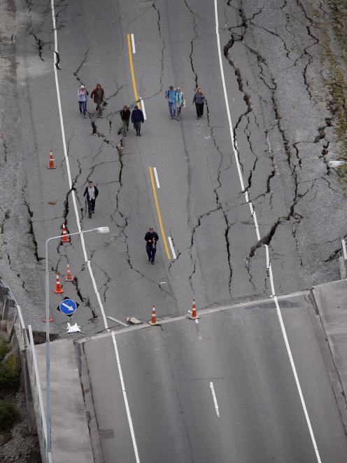 People walking over the South Brighton bridge after Christchurch was hit by a 6.3 magnitude earthquake. Photo: Sarah Ivey