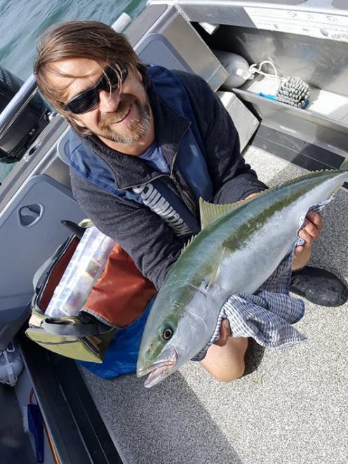 Dunedin recreational fisherman Brent Russell with a kingfish he caught near Quarantine Island at...