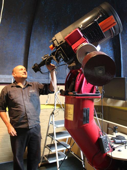 Dunedin Astronomical Society volunteer Stu Todd checks the camera on the main telescope at Beverly Begg Observatory. PHOTO: ELLA STOKES