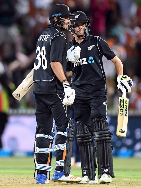 4ad646caa4c Mitchell Santner and Tim Southee celebrate their heroic last over win  against England. Photo