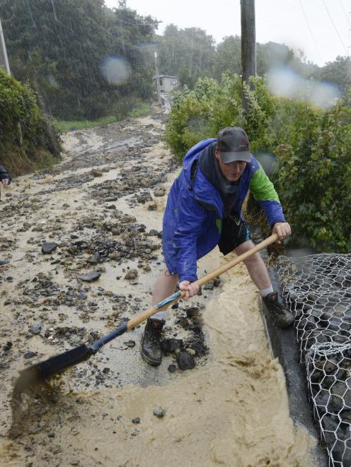 Lindsay Rd resident Kelvin Pearce resumes battle after a stormwater culvert burst for the sixth...