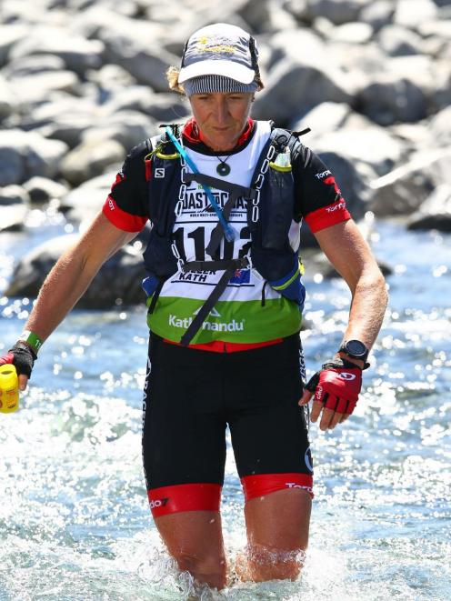 Otago multisport athlete Kath Kelly crosses a river during the 2018 Coast to Coast earlier this...