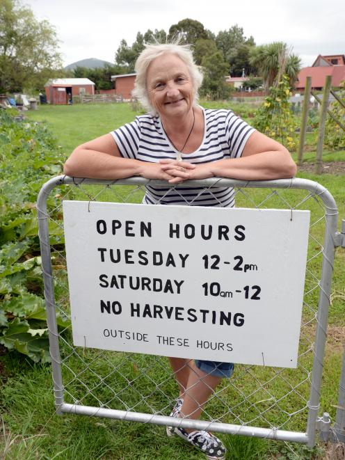 Green Island community garden co-ordinator Marion Thomas with a new sign to discourage theft from...