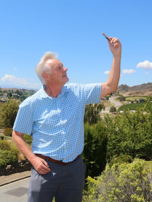 Richard McKenzie tests the uv2Day app in the hot Alexandra sun. Photo: Tom Kitchin