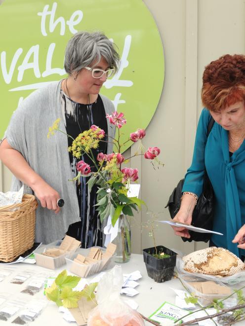 Seedy Sunday co-ordinator Sarah Gallagher (left) and Dunedin resident Sandra Cumming admire the...