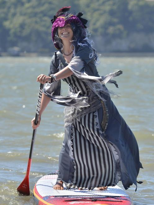 Sarah Louise Smith in her ghost pirate get-up  paddling on Otago Harbour this week. Photo: Gerard...