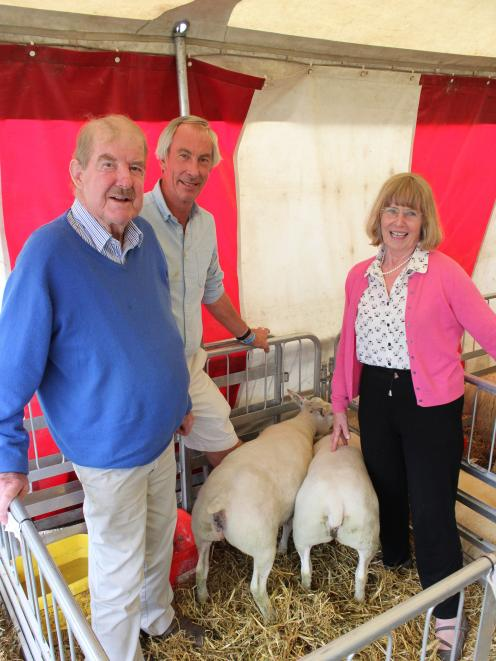 Beltex breeders, from left, Jock Allison, Blair Gallaghar and Hilary Allison show off the Beltex's meaty behinds at the Southern Field Days in Waimumu recently. Photo: Nicole Sharp