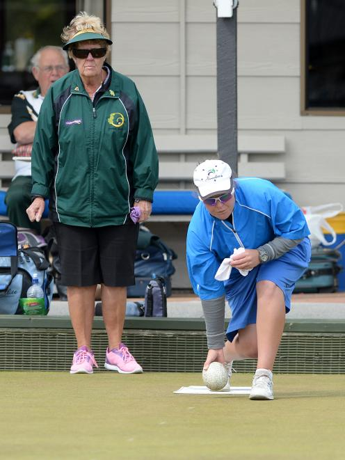 Sarah Scott, of Invercargill but representing Dunedin, delivers a bowl as opponent Margaret O'Connor, of Queenstown, watches on at the national championships southern zone two regional playoffs at the Taieri Bowling Club yesterday. Photo: Linda Robertson