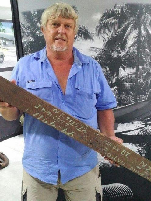 The chairman of Vanuatu's South Pacific World War 2 Museum, Bradley Wood, holds the timber...