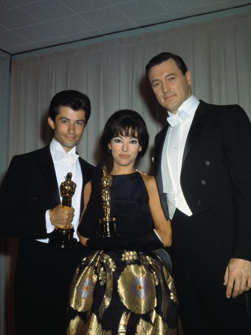 Rita Moreno wearing the dress in 1962 with fellow Oscar winner  George Chakiris  and Rock Hudson....