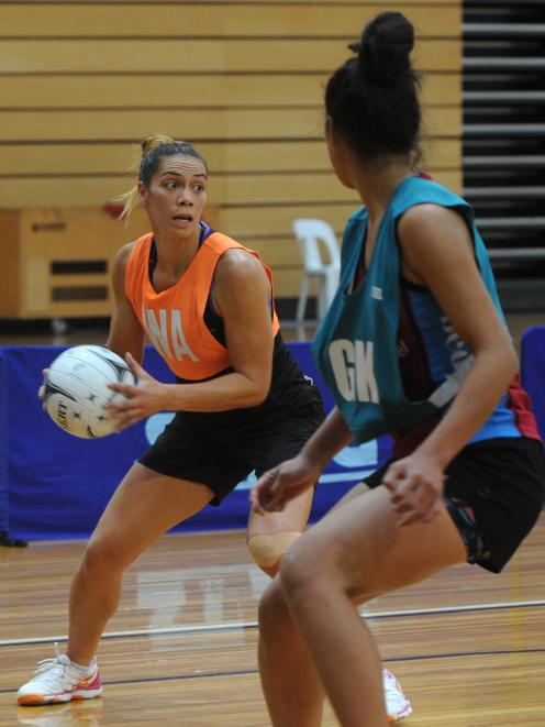 Silver Ferns goal attack Grace Kara (nee Rasmussen) controls the ball as Southern Steel goal keep Taneisha Fifita looks on during the training match at the Edgar Centre yesterday. Photo: Christine O'Connor