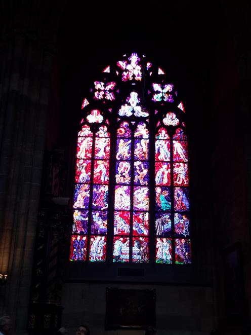 Glorious stained-glass windows inside Prague Cathedral.