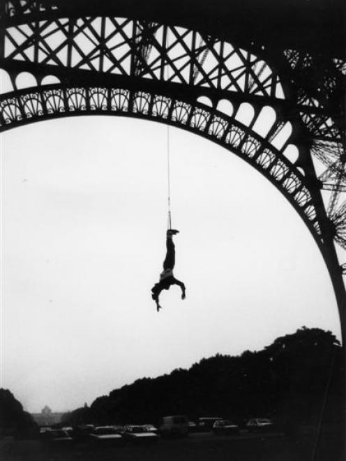 AJ Hackett bungy jumps off the Eiffel Tower in 1987. Photos supplied.