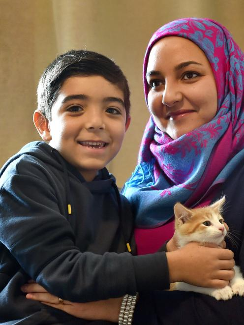 Former refugee Lama Tarawia and son Jawad Mattar (7) with their young kitten at their home in Kew...