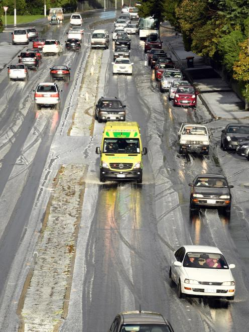 An ambulance crawls through the slush on Stuart St. A short but sharp hailstorm yesterday...