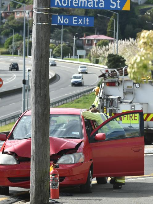 Emergency services attend an accident in Green island on Monday morning. Photo: Gregor Richardson