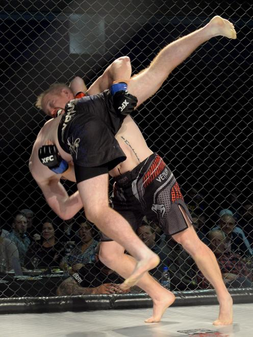 James McBride (Universal Vale Tudo, Christchurch, facing camera) tips over and takes down Flynn...