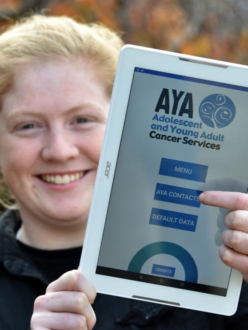 Otago Polytechnic bachelor of information technology student Samantha Watson displays a new app...