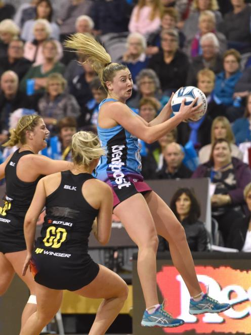 Southern Steel wing attack Gina Crampton leaps to take the ball in front of Waikato-Bay of Plenty Magic defenders Lisa Mather (left) and Hayley Saunders during an ANZ Premiership match at the Edgar Centre in Dunedin last night. Photo: Peter McIntosh